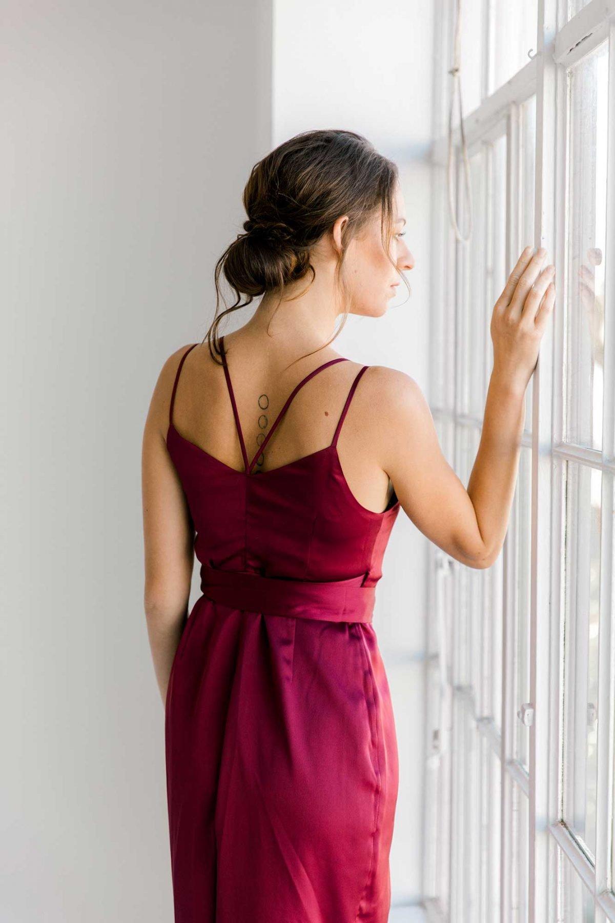 Anya dress in burgundy colour back view