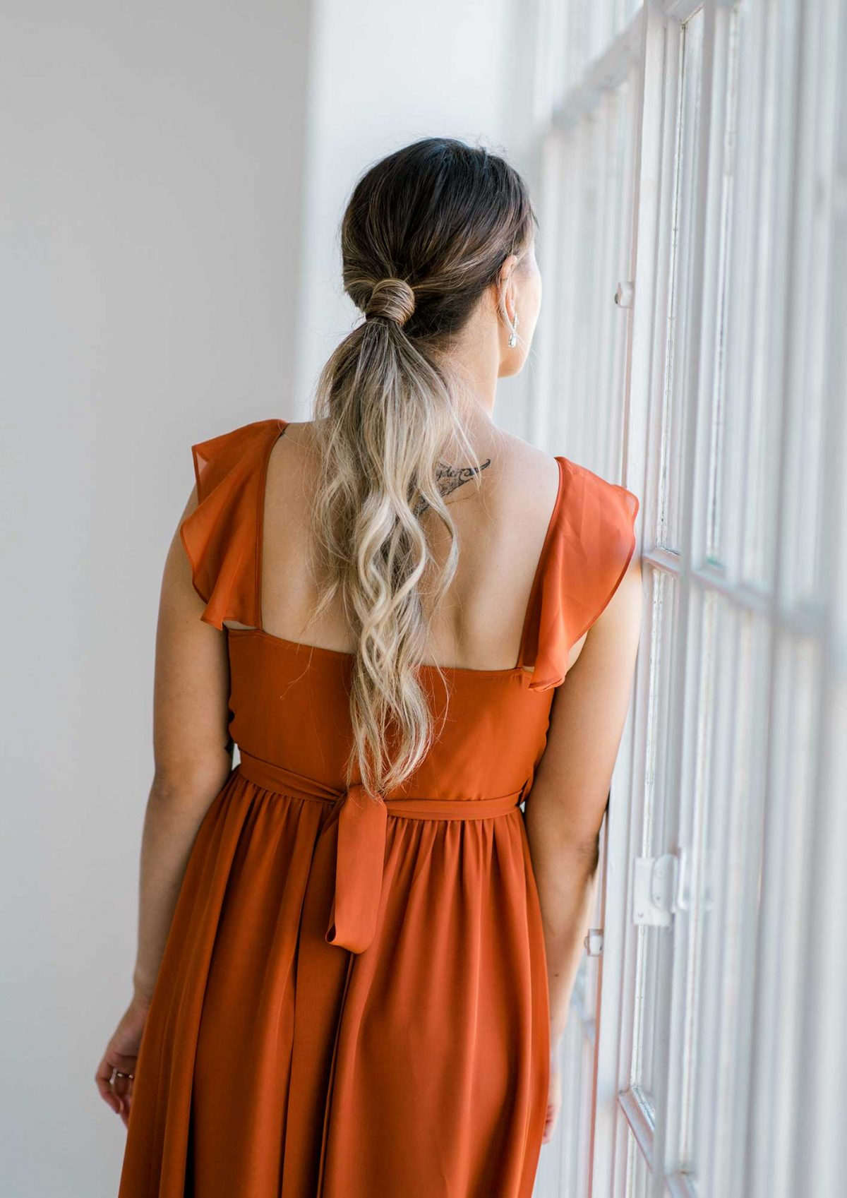 Gemma dress in burnt orange colour close back view