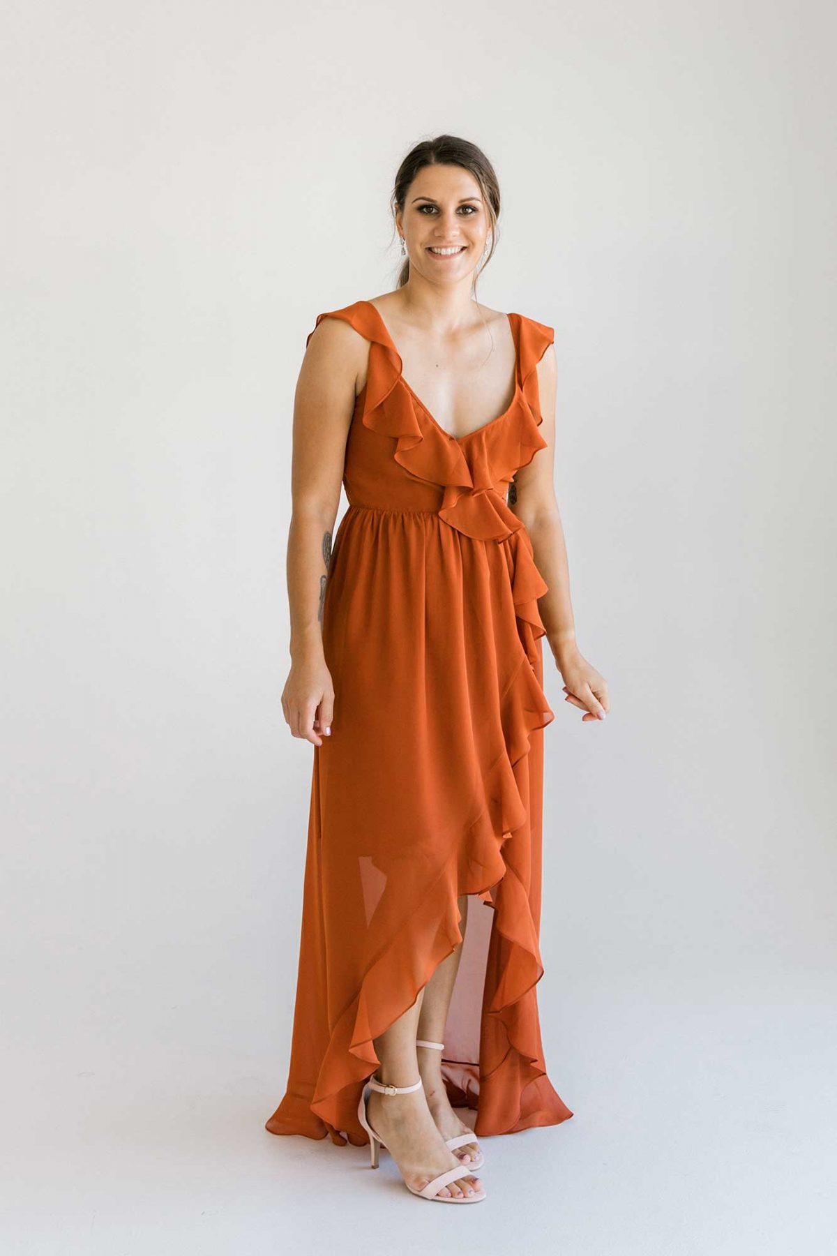 Gemma dress in burnt orange colour front view