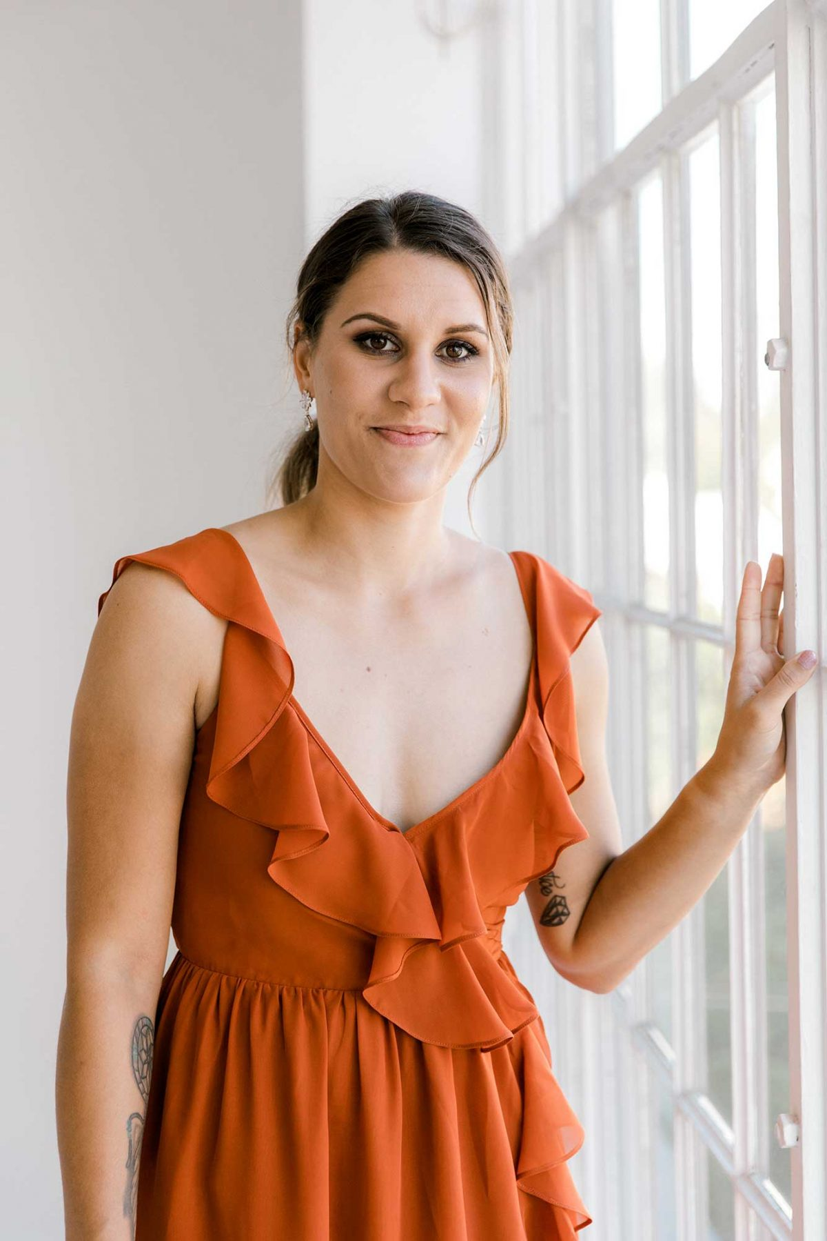 Gemma dress in burnt orange colour close front view