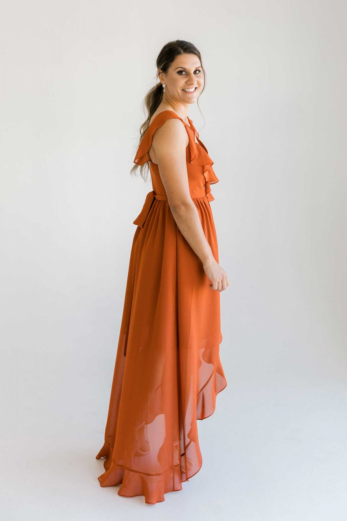 Gemma dress in burnt orange colour side view