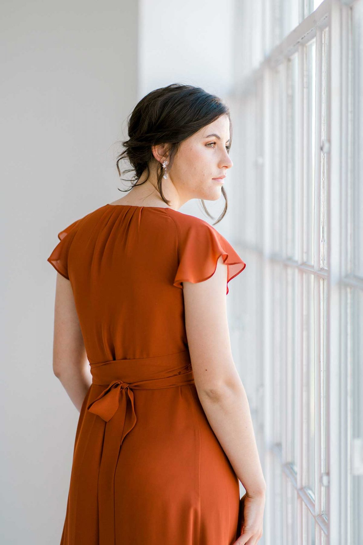 Marianne dress in burnt orange colour close back view