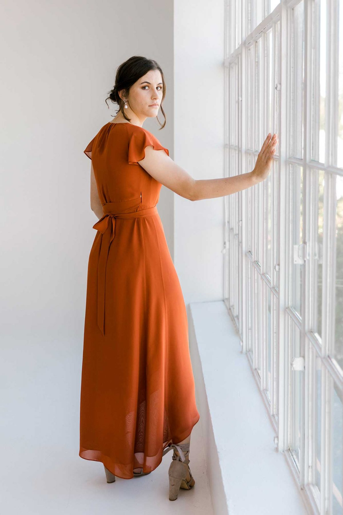 Marianne dress in burnt orange colour side view