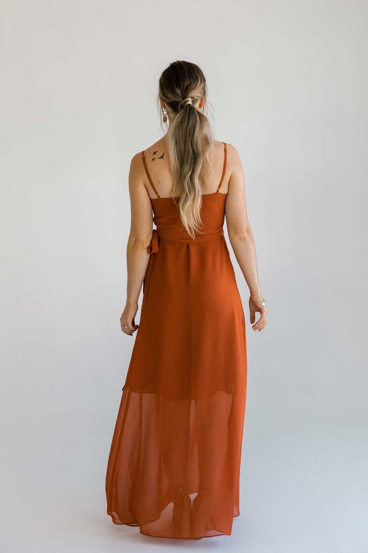Lucinda dress in burnt orange colour back view