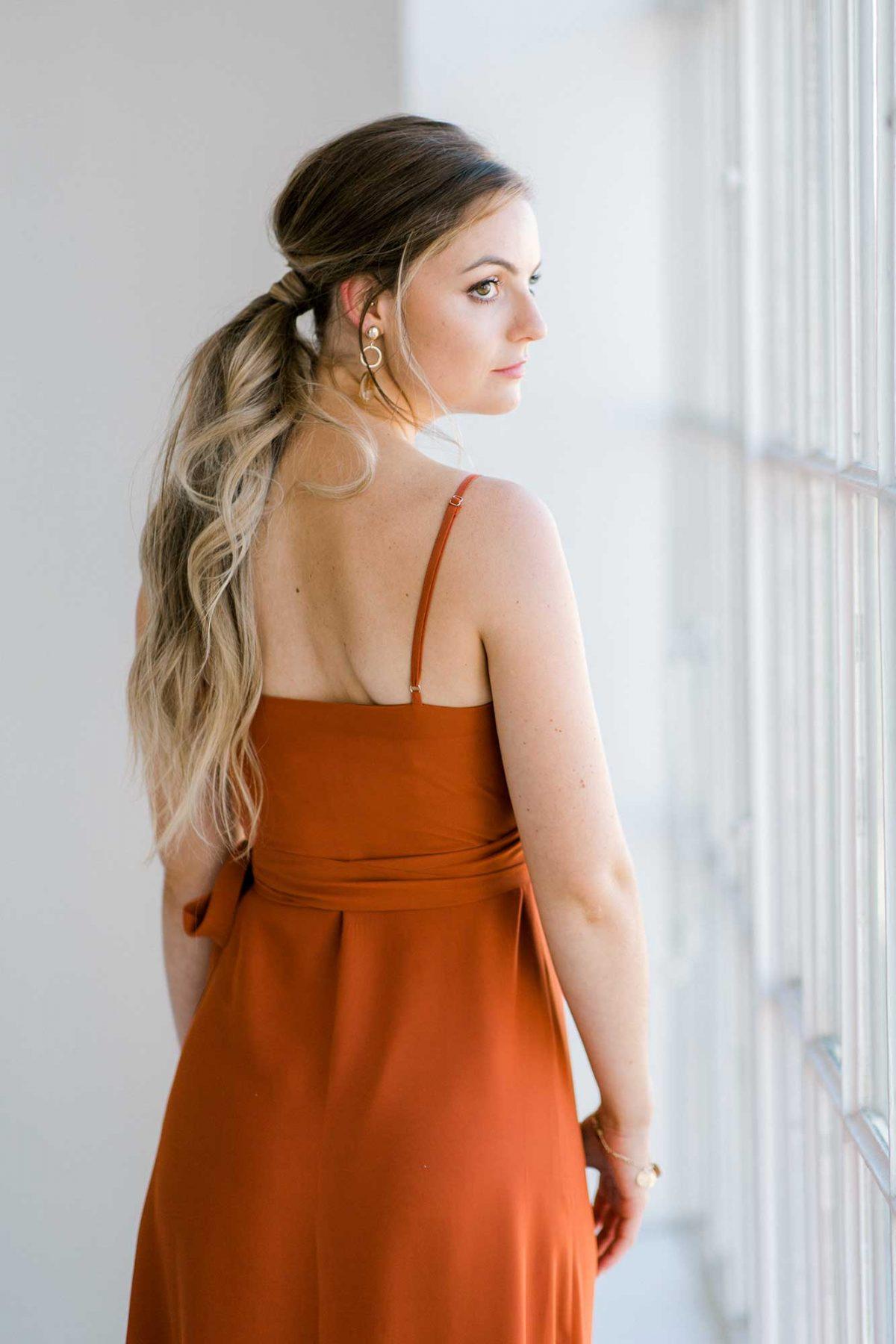 Lucinda dress in burnt orange colour close back view