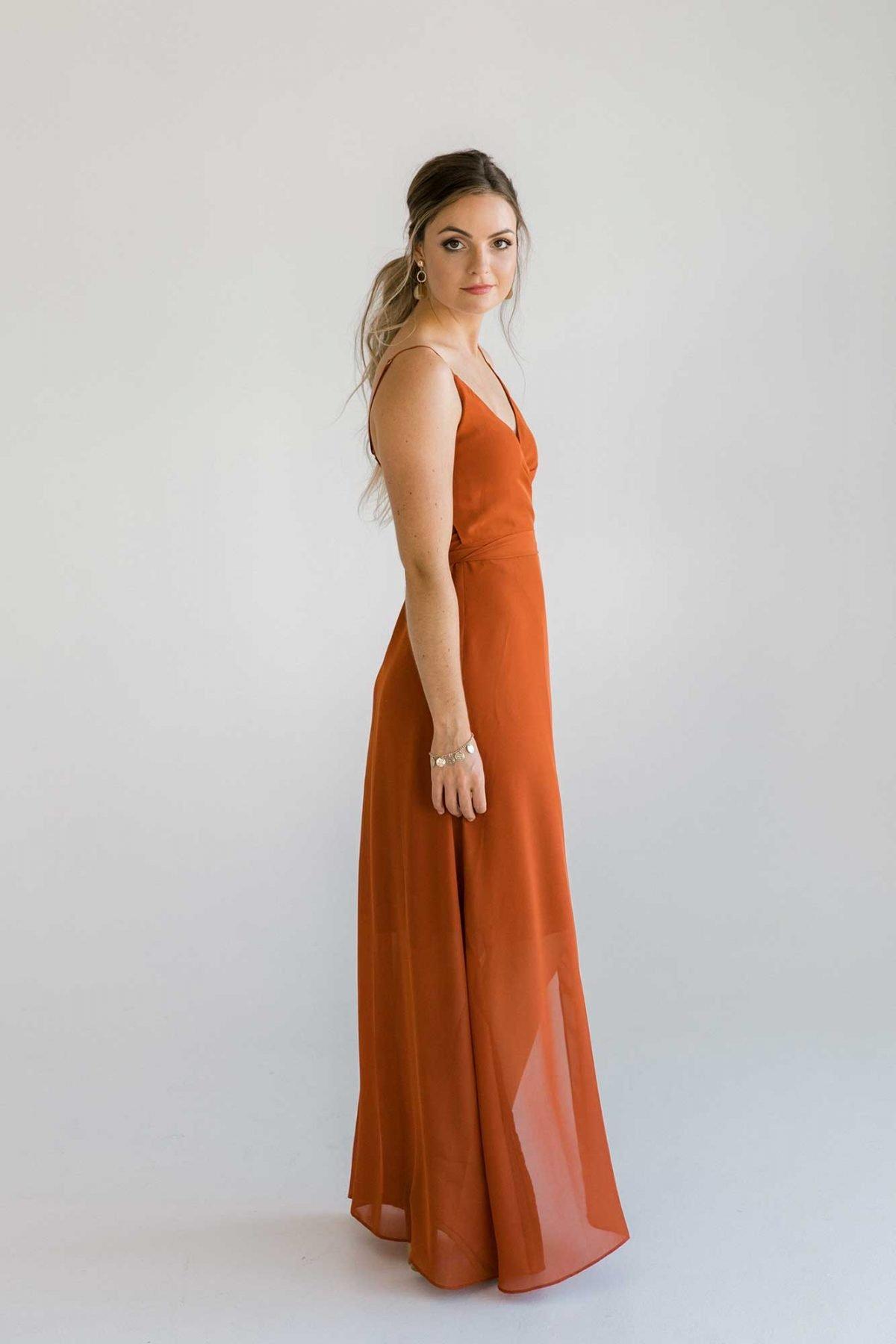 Lucinda dress in burnt orange colour side view