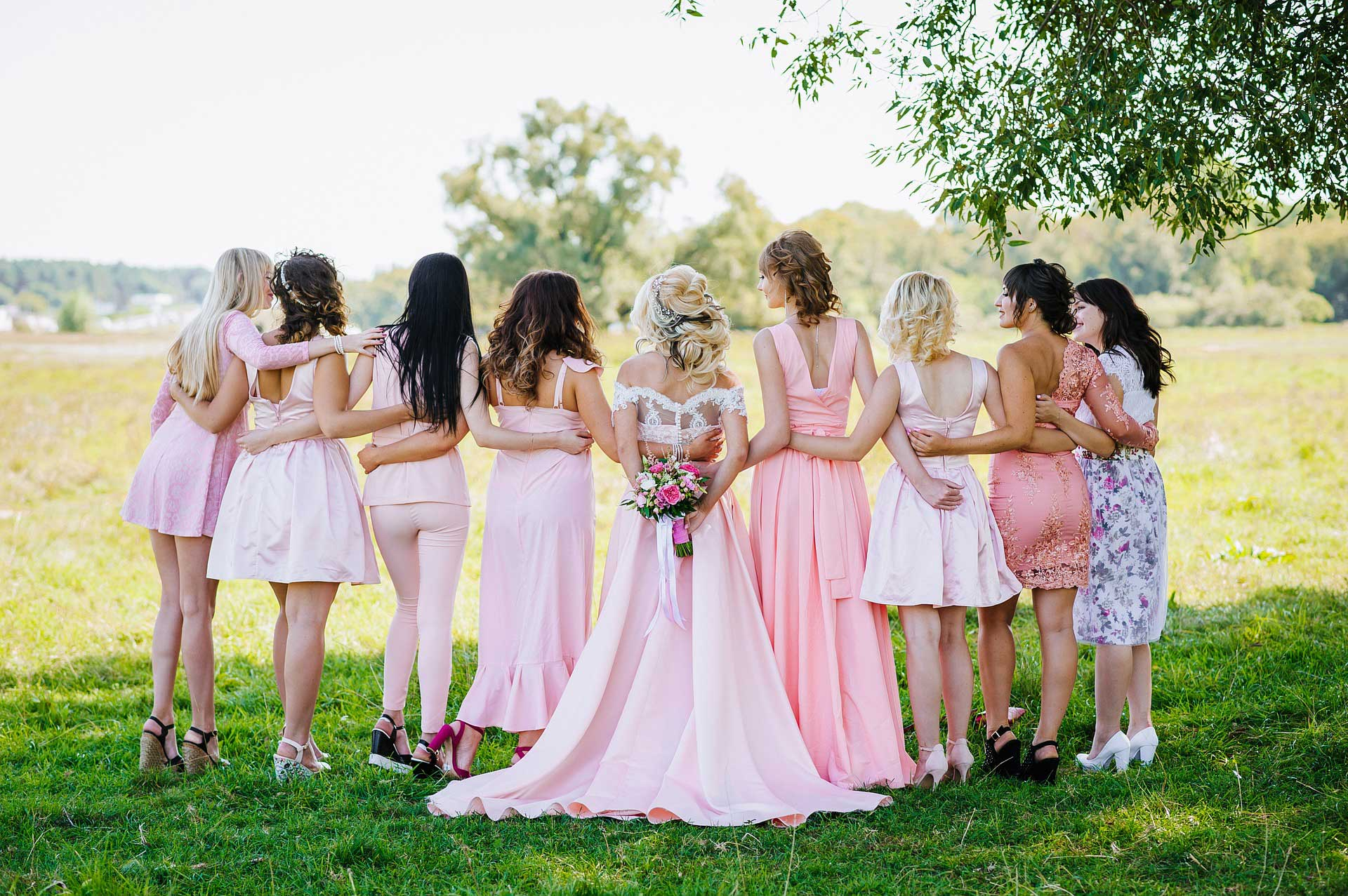 Mixed match bridesmaid dresses in pink colour