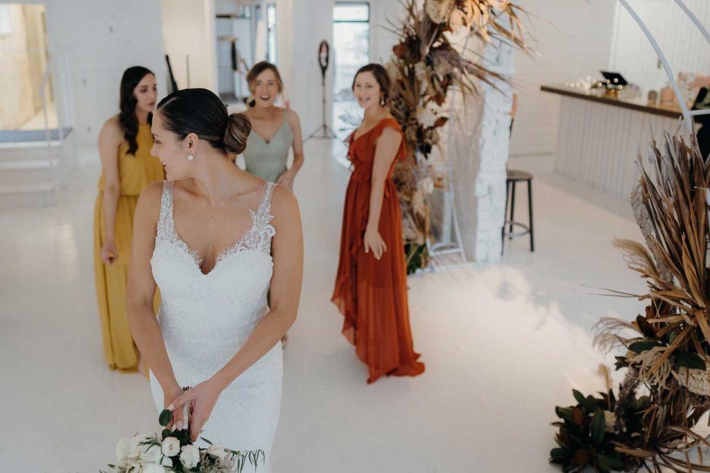 Brides throwing bouquet
